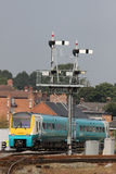 Train passing signal gantry at Shrewsbury station Stock Photography