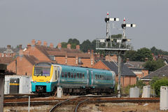 Train passing signal gantry at Shrewsbury station Royalty Free Stock Image