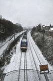Train Passing during a Snow Day Royalty Free Stock Images