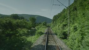 A train passing through some woods. A on board shot of a train passing through some woods stock video footage