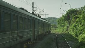 A train passing through some woods. A video shot of a train passing through some woods stock video footage