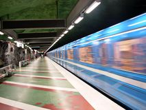 Train passing through station. A view of a blue subway train passing by in a blur ad it goes through an underground subway station in Stockholm, Sweden Stock Photography