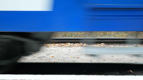 The train is passing by the station. On the video only the lower part, the wheels.  stock footage