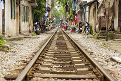 Train passing through streets of hanoi slums, vietnam Royalty Free Stock Photos