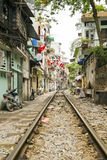 Train passing through streets of hanoi slums, vietnam Stock Photos