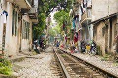Train passing through streets of hanoi slums, vietnam Stock Images