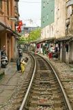 Train passing through streets of hanoi slums, vietnam Stock Photo