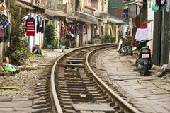 Train passing through streets of hanoi slums, vietnam Royalty Free Stock Photo