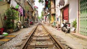 Train passing through streets of hanoi slums,vietnam stock footage