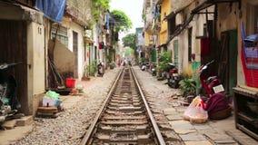 Train passing through streets of hanoi slums,vietnam stock video footage