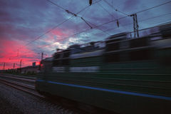 Train passing by on sunset beam Royalty Free Stock Photos