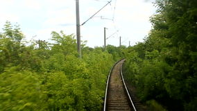 Train passing thru forest. Locomotive view stock footage