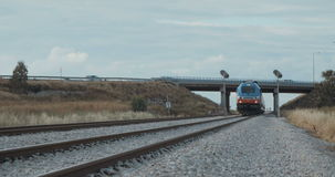 Train passing on the tracks at high speed stock footage