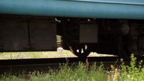 Railway for the Train. A train passing through urban areas, moving railroad tracks stock footage