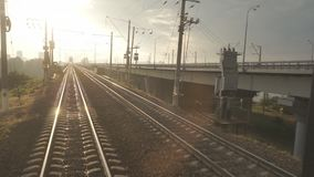 Railway for the Train. A train passing through urban areas, moving railroad tracks stock video footage