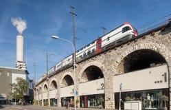 Train passing viaduct Stock Photo