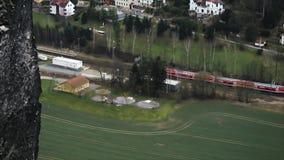 Train passing through the village.  stock video