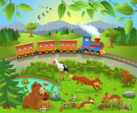 Train passing by wild animals Royalty Free Stock Photos