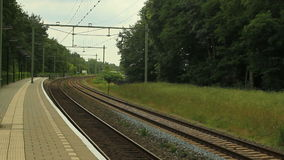 Train passing. Yellow and blue passenger train passing by at high speed stock video