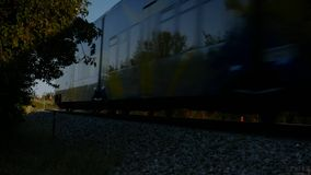 Train Passing. Yellow Train Passing By A Railway Crossing stock video