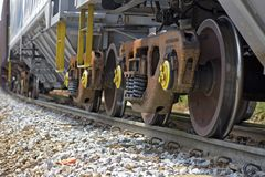 Train perspective from the viewpoint of wheels and rail Royalty Free Stock Photo