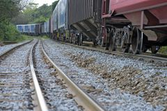 Train perspective from the viewpoint of wheels and rail Stock Photo