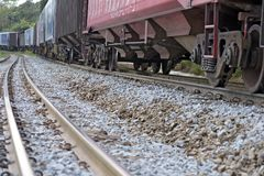 Train perspective from the viewpoint of wheels and rail Stock Photography