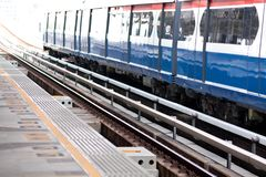 Train platform. Rail Transportation Rail platform area with a parked train Stock Image