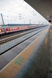 Train platform. Perspective with rushing train. Qinhuangdao, China Royalty Free Stock Photo