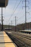 Train Platform. Empty electric rail road train tracks and platform Royalty Free Stock Images
