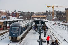 Train at the platform at Naestved train station in Denmark with people waiting for another train royalty free stock images