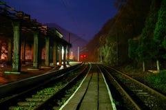 Train platform by night Royalty Free Stock Photography