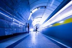 Train on platform in subway Stock Image