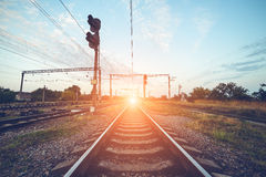Train platform and traffic light at sunset. Railroad. Railway st Royalty Free Stock Image