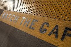 Train platform with watch the gap sign Royalty Free Stock Images
