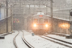 Train plowing through snow storm Royalty Free Stock Photo