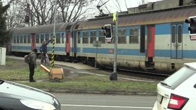 OLOMOUC, CZECH REPUBLIC, JANUARY 18, 2018: Train in poor technical condition and very old, passes at the crossing in. Train in poor technical condition and very stock video footage