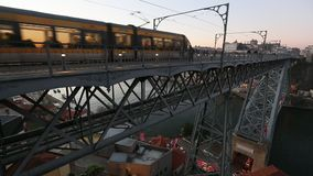 Train of Porto Metro on Dom Luis iron Bridge in Old Town. stock video