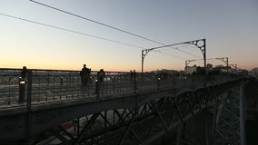 Train of Porto Metro on Dom Luis iron Bridge in Old Town. PORTO, PORTUGAL - DEC 28, 2016: Train of Porto Metro on Dom Luis iron Bridge in Old Town. The network stock video footage