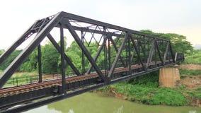 Train pratt truss steel bridge over Pasak river Thailand Royalty Free Stock Photo