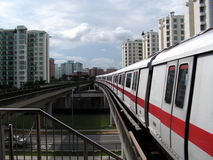 Train pulling into station. Train coming into the station in Singapore Royalty Free Stock Photos