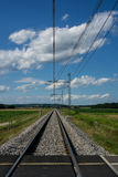 Train Rail. Railway tracks traveled by electric train Royalty Free Stock Photo