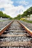 Train rail tracks. On a blue sky and clouds background stock images