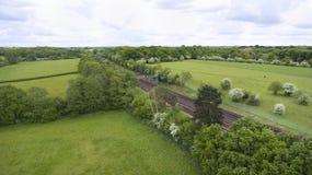 Train rail tracks through countryside, aerial view Stock Photos
