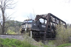 Train. A train on rail tracks with trees Royalty Free Stock Photography