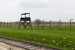 Free Train Rail, Watch Tower And The Ruins Of The Old Barracks From Birkenau Royalty Free Stock Photography - 167430957