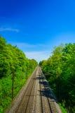 Train railroad against sunny blue sky. Stock Photo
