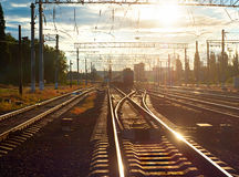 Train on railroad at sunset Royalty Free Stock Photography