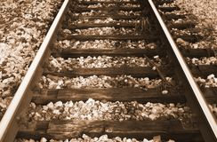 Train rails. Sepia image of train rails Royalty Free Stock Images