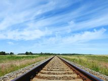 Train rails in summer field, Lithuania Royalty Free Stock Images